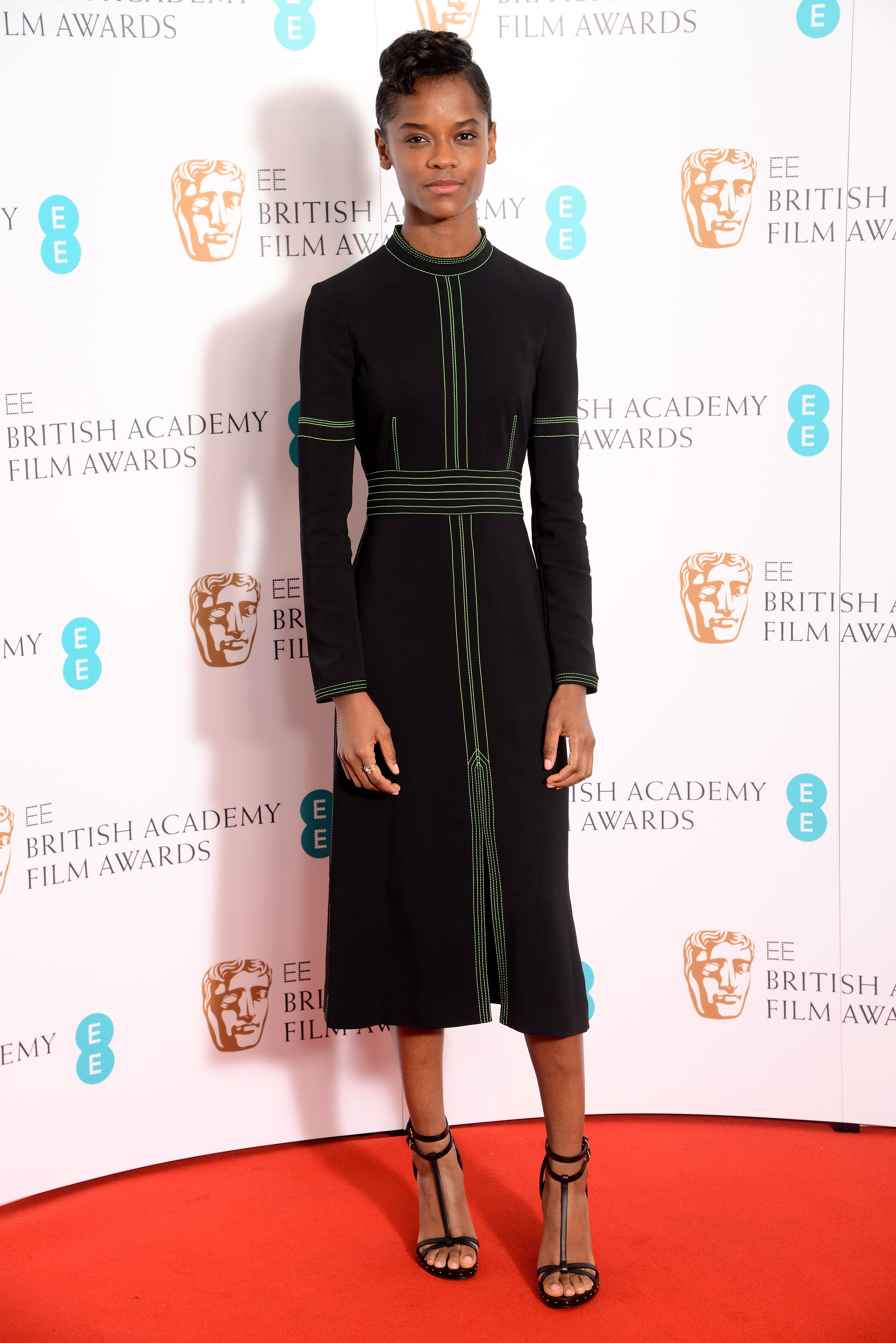 Letitia Wright wears a Burberry topstitch detail dress at the ...
