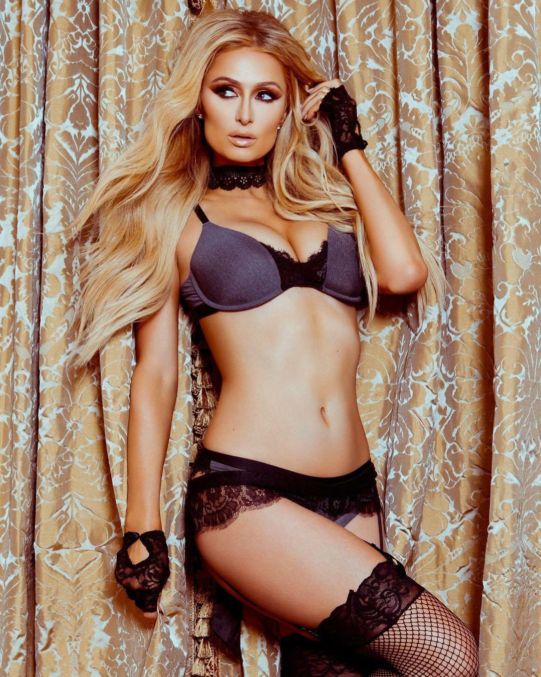 Paris Hilton ramps up the raunch in bra, stockings and ...